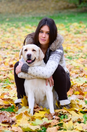Brunette girl with dog in nature Stock Photo - 16335140