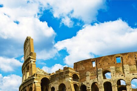 Colosseum in Rome with blue sky photo
