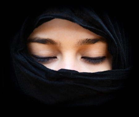arab girl: Portait of woman wearing scarf with eyes closed