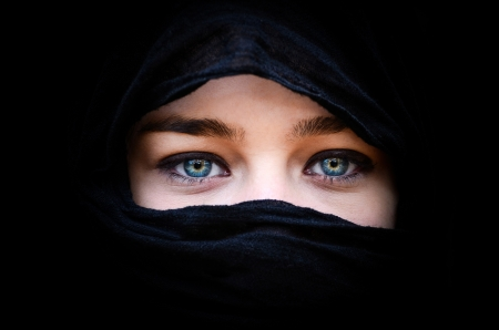 mystery of faith: Portrait of beautiful woman with blue eyes wearing black scarf