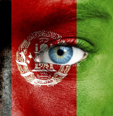 afghanistan flag: Human face painted with flag of Afghanistan