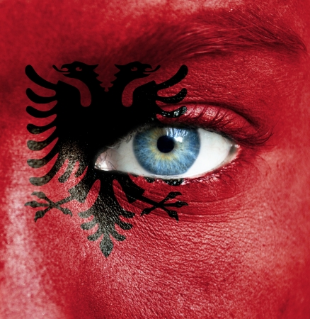 Human face painted with flag of Albania photo