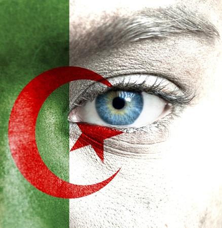 Algeria: Human face painted with flag of Algeria