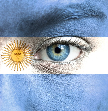 Human face painted with flag of Argentina Stock Photo
