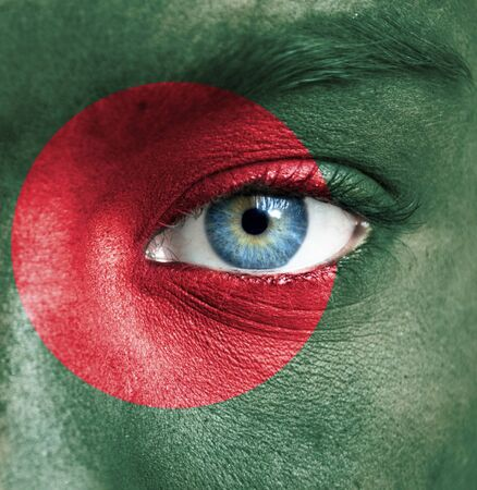 the national team: Human face painted with flag of Bangladesh