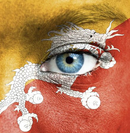 Human face painted with flag of Bhutan Stock Photo - 16523653
