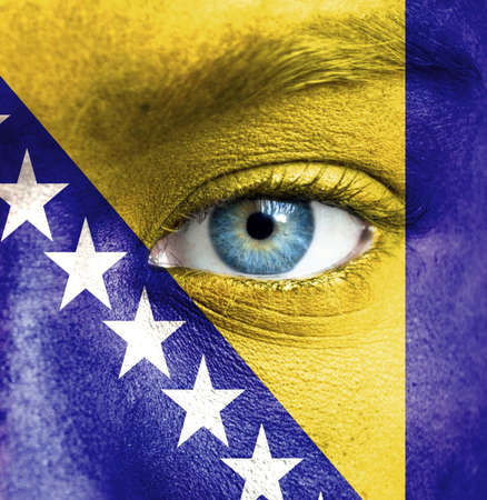 Human face painted with flag of Bosnia and Herzegovina photo