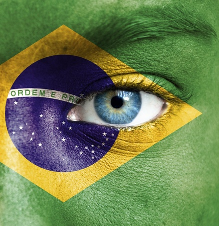 brasil: Human face painted with flag of Brazil
