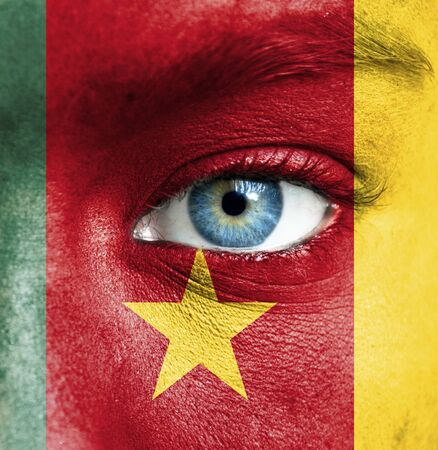 Human face painted with flag of Cameroon Stock Photo - 16523533