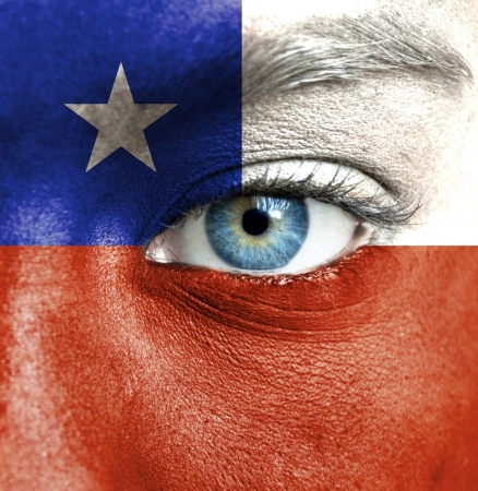 Human face painted with flag of Chile Stock Photo - 16523628