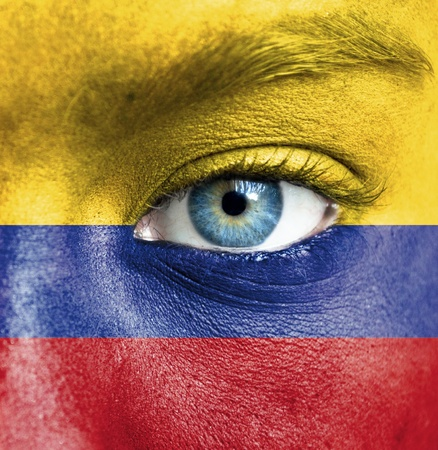 Human face painted with flag of Colombia Stock Photo