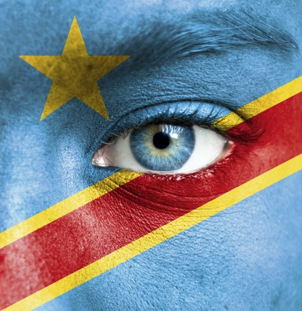 Congo: Human face painted with flag of Democratic Republic of Congo