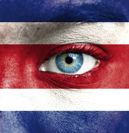 Human face painted with flag of Costa Rica photo