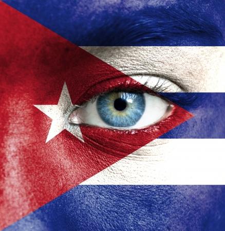 cuba flag: Human face painted with flag of Cuba