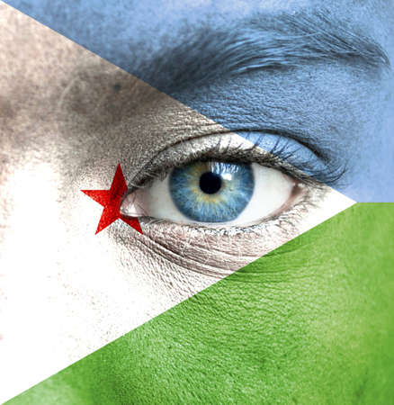 Human face painted with flag of Djibouti