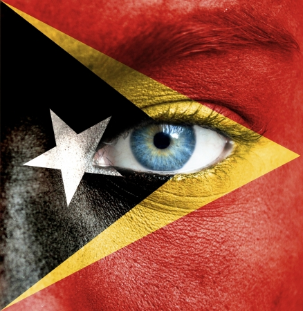 Human face painted with flag of East Timor Stock Photo - 16509089