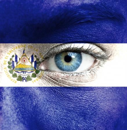 el salvador flag: Human face painted with flag of El Salvador Stock Photo