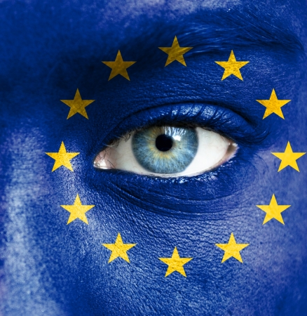 europe closeup: Human face painted with flag of European Union