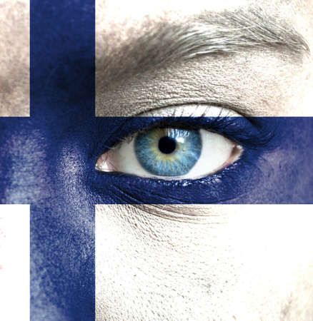 Human face painted with flag of Finland Stock Photo - 16523477