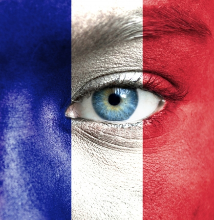 nationalistic: Human face painted with flag of France