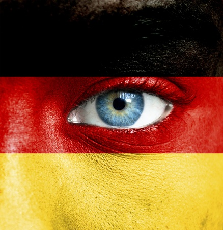 Human face painted with flag of Germany Stock Photo - 16523467