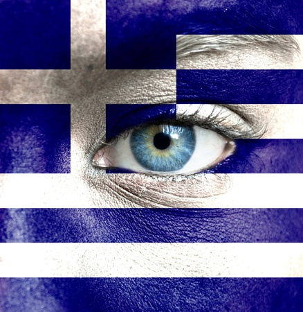 Human face painted with flag of Greece Stock Photo - 16523504