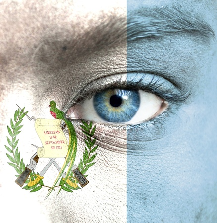 Human face painted with flag of Guatemala photo