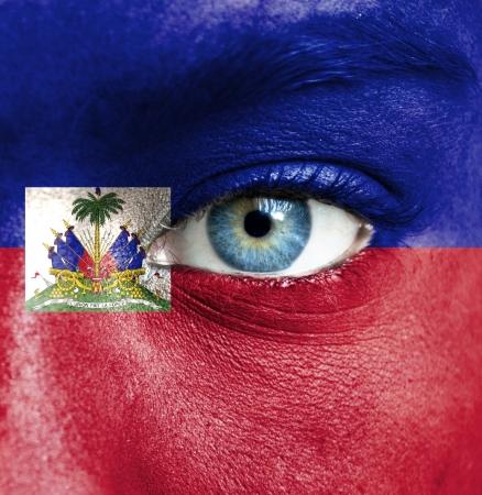 haiti: Human face painted with flag of Haiti Stock Photo