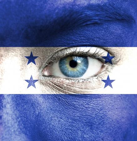 bandera honduras: Rostro humano pintado con la bandera de Honduras