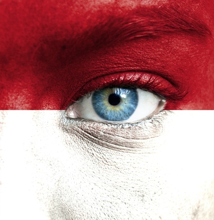 indonesia culture: Human face painted with flag of Indonesia
