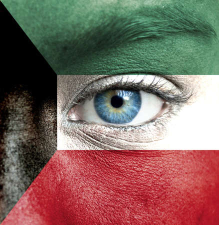 kuwait: Human face painted with flag of Kuwait