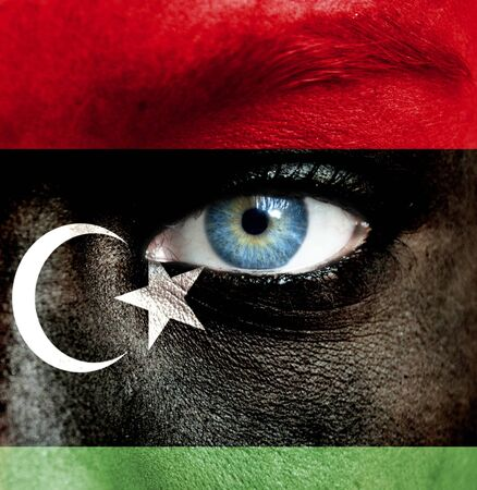 Human face painted with flag of Libya Stock Photo - 16523500