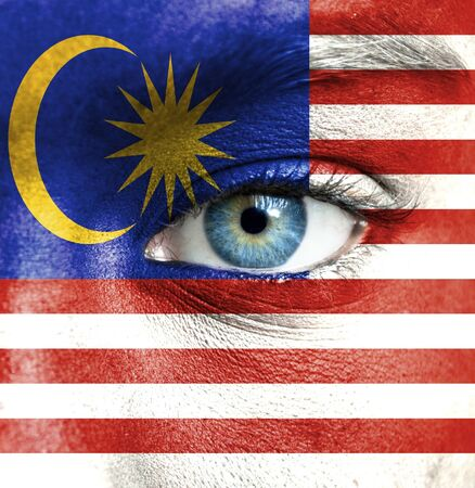 malaysia culture: Human face painted with flag of Malaysia Stock Photo