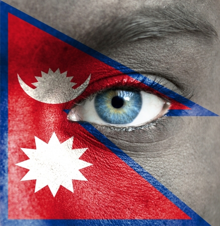 Human face painted with flag of Nepal