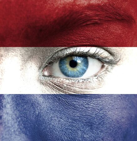 Human face painted with flag of Netherlands photo