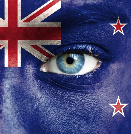new zealand flag: Human face painted with flag of New Zealand