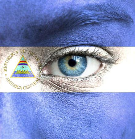 Nicaragua: Human face painted with flag of Nicaragua