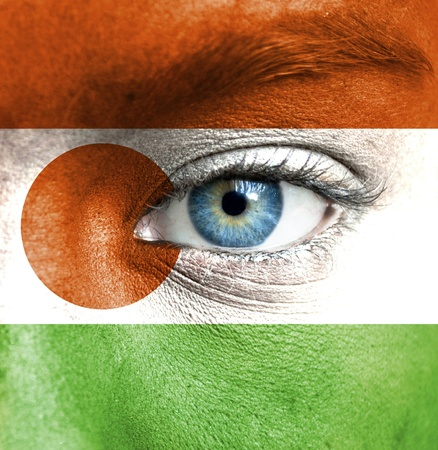 niger: Human face painted with flag of Niger