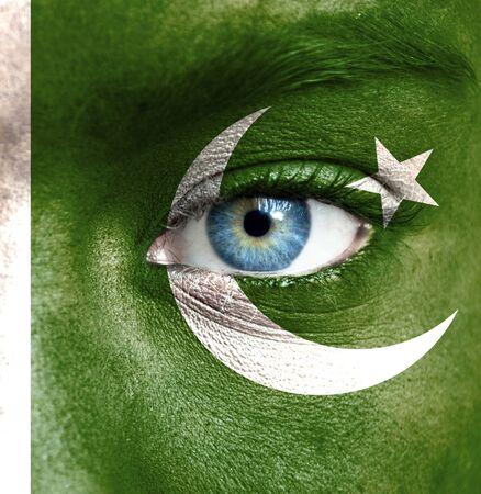 Pakistan: Human face painted with flag of Pakistan Stock Photo
