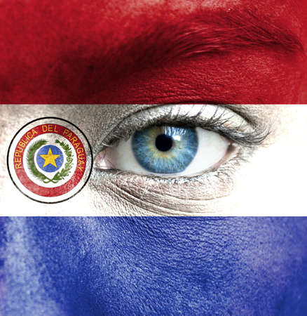 paraguay: Human face painted with flag of Paraguay Stock Photo