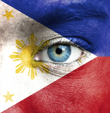 Human face painted with flag of Philippines photo