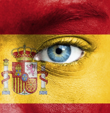 the national team: Human face painted with flag of Spain
