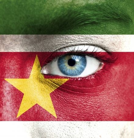 Human face painted with flag of Suriname Stock Photo - 16523557