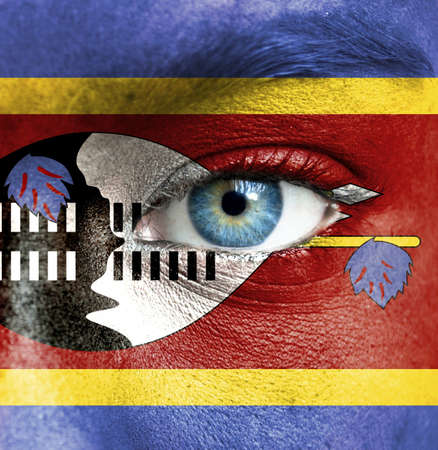Human face painted with flag of Swaziland Stock Photo - 16523614