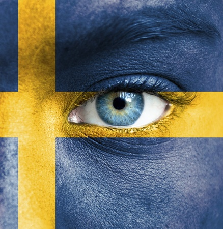 Human face painted with flag of Sweden Stock Photo - 16523567