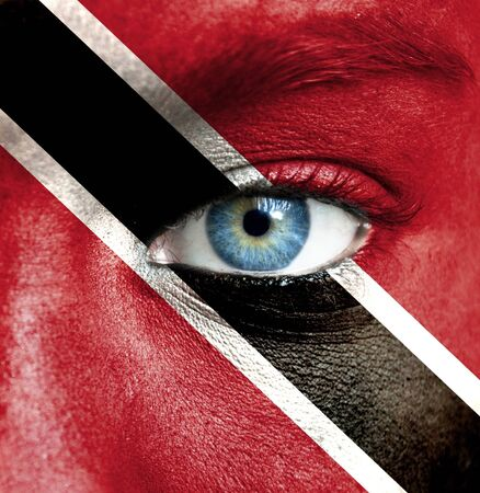 Human face painted with flag of Trinidad and Tobago photo
