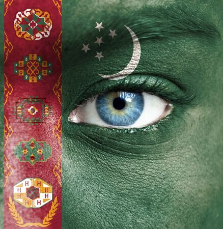 Human face painted with flag of Turkmenistan photo