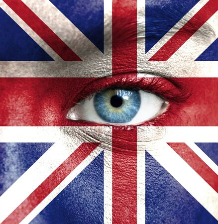 Human face painted with flag of United Kingdom Stock Photo - 16523559