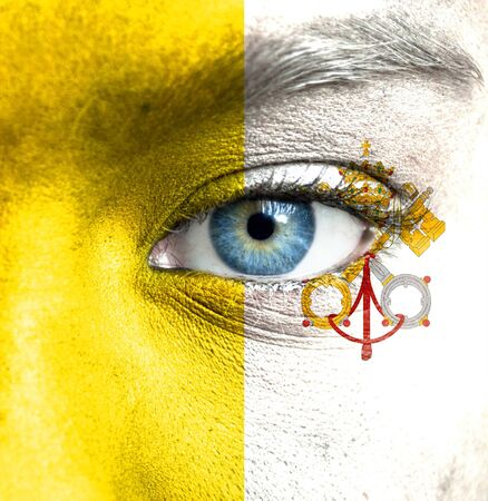 Human face painted with flag of Vatican Stock Photo - 16523535