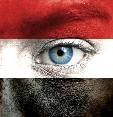 Human face painted with flag of Yemen
